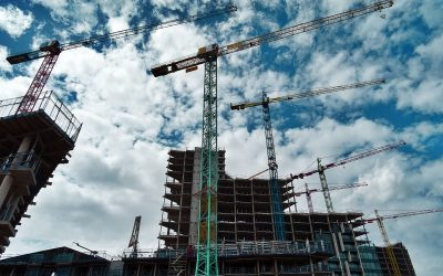 Why do construction projects frequently go over budget?